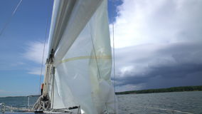 The yacht changes tack. The wind blew up the sail of yacht.