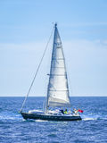 Yacht in Choppy Sea. A small yacht, with all hands on deck, sailing in choppy seas, on a warm balmy day, in the English Channel Royalty Free Stock Photos