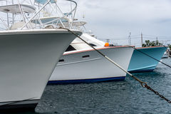 Yacht closeup in harbor. Yachts in harbor in ocean water Stock Photo