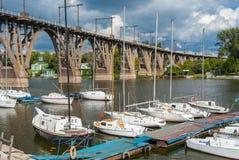 Yacht-club anchorage at arched bridge at fall season Stock Photos