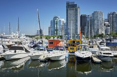 Yacht Club Terminal at the waterfront, in front of modern high rise business buildings royalty free stock image