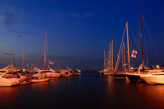 Yacht club at twilight. Yachts in the marina at twilight Stock Photos