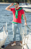 Yacht club. Young successful businessman holding time on the yacht Royalty Free Stock Images