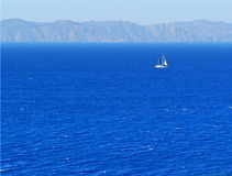Yacht by a coast. Yacht on a sea and coast of Turkey. Rhodes, Greece stock images