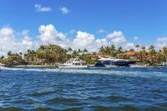 Yacht at Coastal Mansion Stock Image