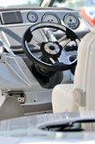 Yacht control gage and steering wheel. Steering wheel and gage in small yacht, shown as entertainment, holiday or marine activity Royalty Free Stock Photography