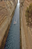 Yacht in the Corinth Canal. A small yacht makes way through the Corinth Canal which is a canal that connects the Gulf of Corinth with the Saronic Gulf in the Stock Images