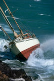 Yacht crash on the rocks Stock Photo