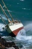 Yacht crash on the rocks Stock Photo