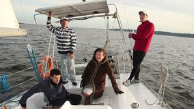 Yacht crew on deck, company, friends, traveling, tourism. Stock footage stock video footage
