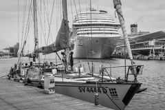 Yacht and cruise ship moored at the cruise port of Savona, Italy. Savona, Italy - December 2, 2016: Yacht and cruise ship moored in harbor at the Ligurian sea Royalty Free Stock Photo