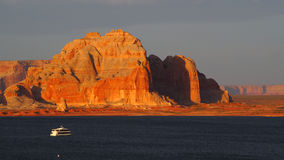 A yacht cruises through Lake Powell at Sunset Stock Photography