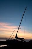 Yacht de coucher du soleil Image libre de droits
