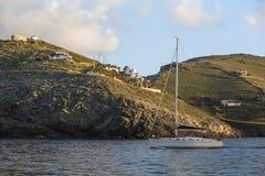 Yacht with a deflated sails near the Greek coast. Travel. Royalty Free Stock Photos