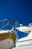Yacht detail. Detail of two yachts, over blue sky Stock Images