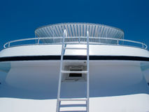 Yacht Detail and Sky. Abstract view on a yacht with ladder, handrail and roof. Bright blue sky royalty free stock photos