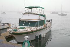 Yacht At Dock. A powerful small size yacht tied to the marina dock stock photo
