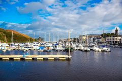 DOUGLAS, ISLE OF MAN - OCTOBER 17: Yacht docking at bay in a nice small port in a clear blue sky day in a small town of Doug Stock Image