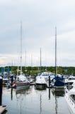 Yacht docking at the marina Stock Images