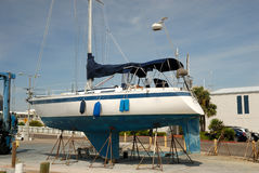 Yacht in the dry dock. For maintenance Stock Photos