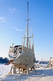 Yacht on dry dock frozen in ice in winter Royalty Free Stock Images