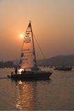 Yacht in estuary. Yacht returning to moor in estuary in late evening light Stock Images