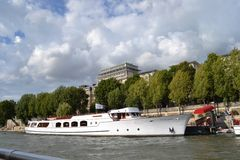 Yacht Excellence, of Yacht de Paris, red carpet at yacht jetty, along Siene River, Paris. Yacht Excellence, of Yacht de Paris, red carpet for guest at yacht Royalty Free Stock Photography