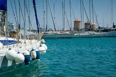 Yacht with fenders. Sailing boat with very many fenders. Rhodes marina, Greece Royalty Free Stock Images