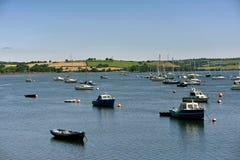 Yacht and fishing boats lies peacefully at anchor in a sheltered. Bay at saltash cornwall uk Stock Photography