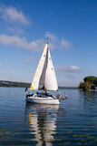 A yacht floating in the lake Royalty Free Stock Photo