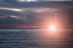 Yacht floating in sea under amazing sunset Royalty Free Stock Photos