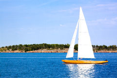The yacht floats by sea Royalty Free Stock Photos