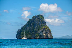Yacht in front of huge rocks, El Nido, Palawan, Philippines. Yacht in front of huge rocks. El Nido Palawan Philippines Royalty Free Stock Image