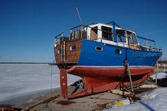 Yacht at frozen harbor. In Orjaku, Kassari, Hiiumaa, Estonia at winter Royalty Free Stock Images