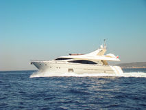 Yacht at full speed. Out to sea Stock Image