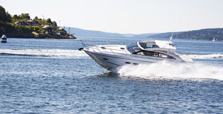 Yacht fun in Norwegian fjord. A yacht speeds by in the Oslo Fjord, Norway, the summer of 2009 Royalty Free Stock Image