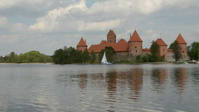 Yacht on Galve lake near Lithuanian historical castle Trakai stock video