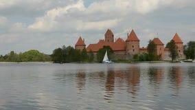Yacht on Galve lake near Lithuanian historical castle Trakai stock video