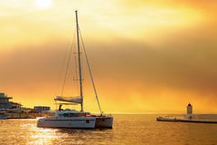 Yacht getting ready to be moored in the harbor of Postira - Croatia, island Brac Royalty Free Stock Photography