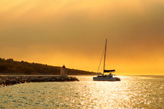 Yacht getting ready to be moored in the harbor of a small town called Postira - Croatia, island Brac Stock Images
