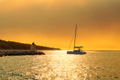 Yacht getting ready to be moored in the harbor of a small town Postira - Croatia, island Brac Royalty Free Stock Photography