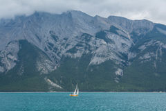 Yacht. Gloomy morning, the boat goes around the lake. yacht , gloomy morning, tourism, travel, Canada, Banff Stock Photo