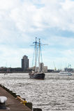 Yacht goes down the river Maas Stock Photography