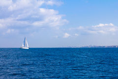 Yacht going to the beach, Mediterranean Sea.  Royalty Free Stock Images