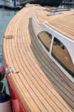 Yacht in harbor. A red yacht with wooden deck, stop in harbor, shown as marine activity, travel or entertainment Royalty Free Stock Photography