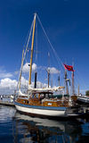 Yacht in harbor. Beautiful yacht in the inner harbor of Victoria, British Columbia Royalty Free Stock Photography