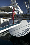 Yacht in the harbor. Rear of a luxury yacht with its footbridge Stock Photo