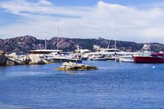 Yacht at the harbour. A little touristic harbour in Sardinia, Italy stock photos