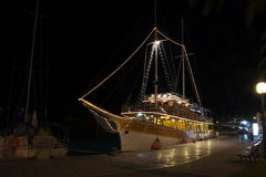 Yacht in harbour at night Stock Photography