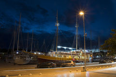 Yacht in harbour at night Royalty Free Stock Images